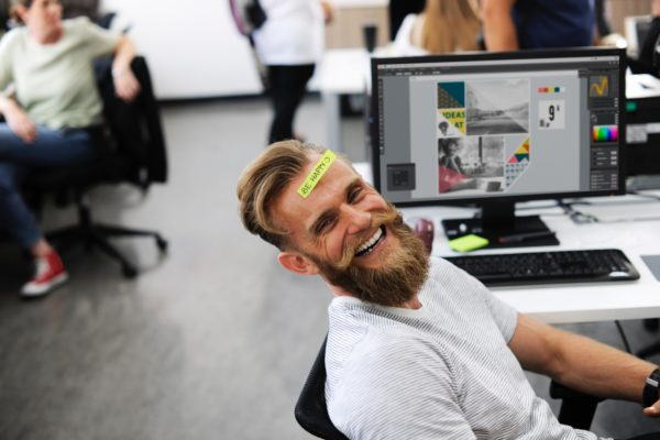 happy man working in an office