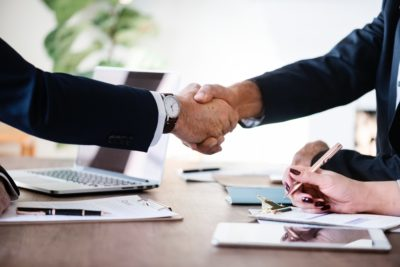 two men shaking hands after a job interview